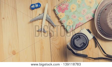 Summer Beach Travel with copy space on wooden floor
