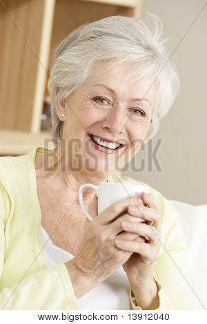 Senior Woman Enjoying Hot Drink At Home