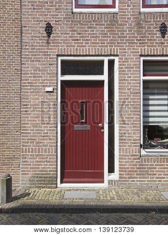 Red closed door in Alkmaar, Netherlands, Europe