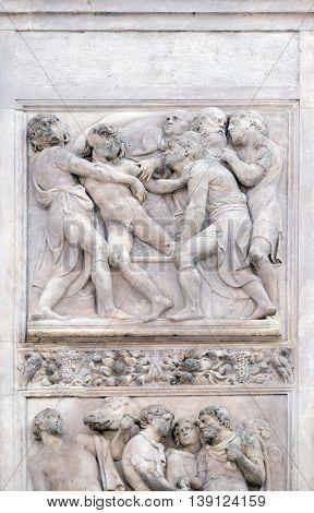 BOLOGNA, ITALY - JUNE 04: Joseph thrown into the cistern by Amico Aspertini, right door of San Petronio Basilica in Bologna, Italy, on June 04, 2015