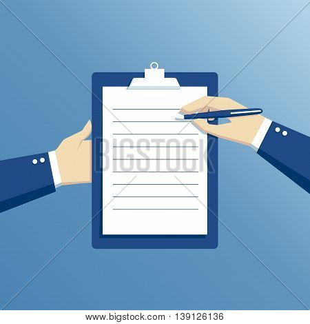 Hand of businessman holding clipboard with blank sheet of paper and pen clipboard with blank paper and pen in the hands