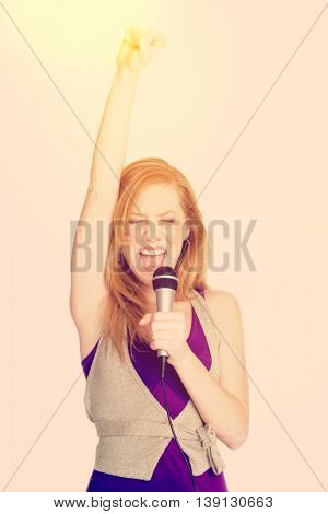 Beautiful redhead woman singing with microphone