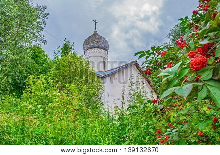 Architecture summer cloudy landscape - Church of the Annunciation in Arkazhi or the Church of the Annunciation on Myachino Lake in Veliky Novgorod Russia