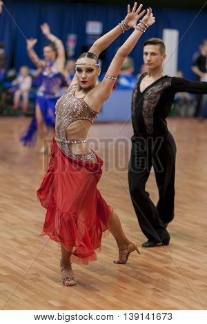 Minsk Belarus -May 29 2016: Adamovskiy Vladislav and Valashimas Stephaniya Perform Youth-2 Latin-American Program on National Championship of the Republic of Belarus in May 29 2016 in Minsk Belarus