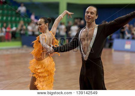 Minsk Belarus -May 29 2016: Senior Dance couple of Zadruckiy Sergey and Zadruckaya Tatiana performs Adult Latin-American Program on National Championship of the Republic of Belarus in May 29 2016 in Minsk Belarus