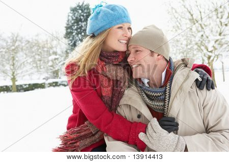 Couple Standing Outside In Snowy Landscape