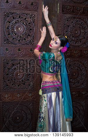 Beautiful Girl In The National Indian Traditional Dress Standing Back In The Dark Room