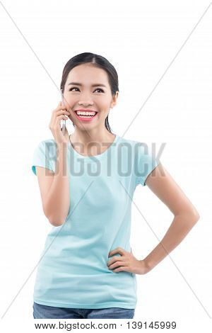 Portrait of smiling young girl talking on the phone