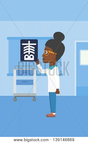 An african-american young female doctor looking at a skeleton radiograph in the medical office. Vector flat design illustration. Vertical layout.