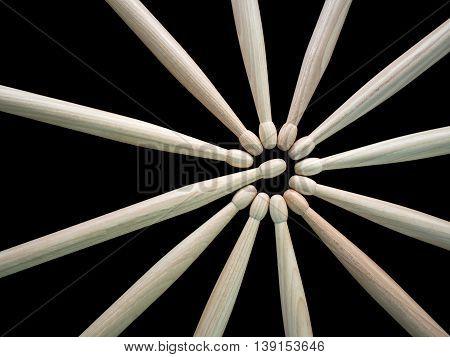 Many drumsticks in black background, close up shot