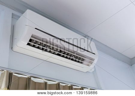 cool air conditioner system on white wall room poster