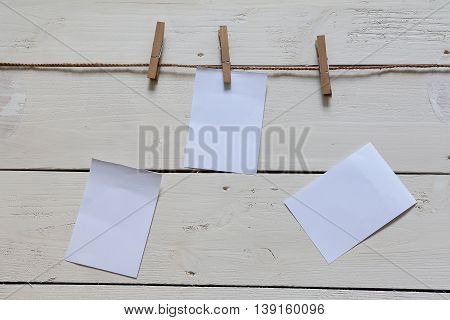 Note pad and clothes pin hanging on string