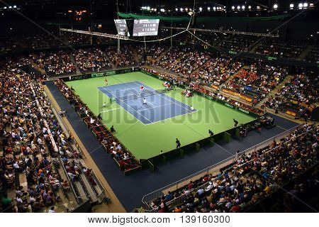 Sport Hall Full With Crowd During A Tennis Match