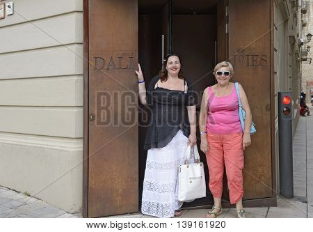 FIGUERES, CATALONIA, SPAIN - JUNE 17: tourist women are standing at the entrance to Dali-Jewels museum of Gala-Salvador Dali Foundation on June 17, 2014 in Figueres, Catalonia, Spain.