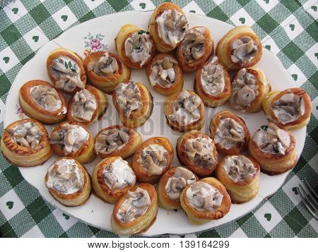 Vol au vents filled with chopped mushrooms and cooking cream