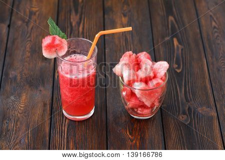 Glasses Of Watermelon Smoothie And Heartshapes On Wooden Background