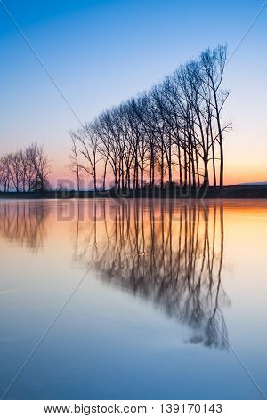 Symmetry - autumn morning on the river before sunrise