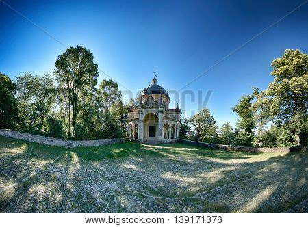 fifth Chapel on the sacred way of the Sacred Mount of Varese in a limpid summer morning Lombardy - Italy