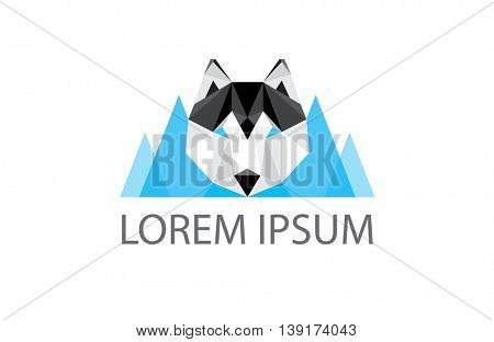 low poly logo - geometric polygonal husky dog head and blue mountains in the background - great logo element for winter outdoor business