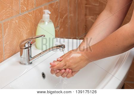 Woman Washing Hands. Cleaning Hands. Hygiene. Water