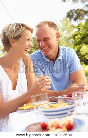 Couple Enjoying Meal In Garden