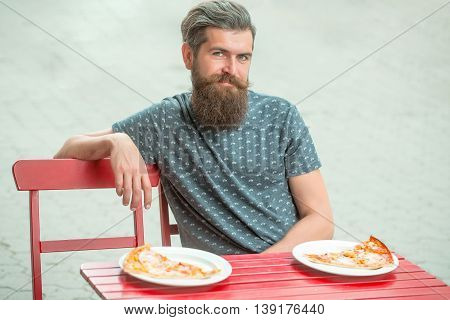 Handsome Bearded Man With Pizza In Cafe