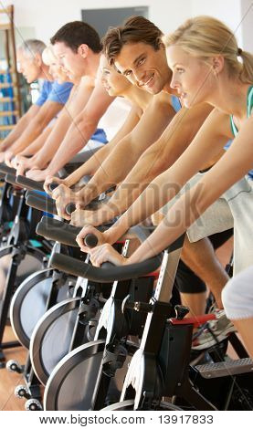 Man Cycling In Class In the Gym