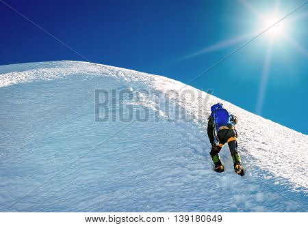 Climber reaches the summit of mountain peak. Climbing and mountaineering sport concept Nepal Himalayas poster