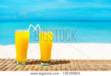 Two tropical fresh juices on tropical beach. Holiday and vacation concept