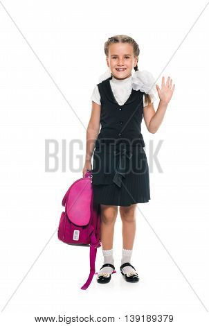Portrait of schoolgirl with pink satchel. Education and school concept