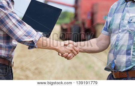 Shaking Hands On Farmland