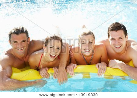 Group of Young friends having fun in pool
