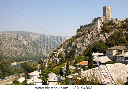 Pocitelj cityscape with an ancient stronghold. Pocitelj is a town in Bosnia and Herzegovina. The historic site of Pocitelj is located on the left bank of the river Neretva. poster