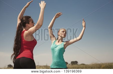 Young  Women Doing Yoga Outdoors Photo Stay And  Poses