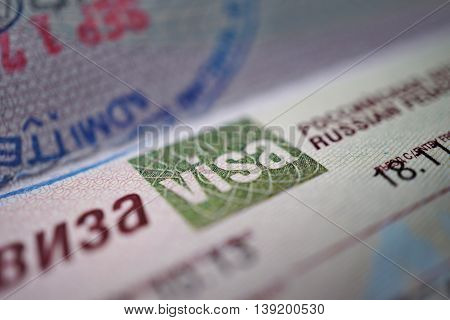 Visa sign in golden emblem as a part of Russian Visa page