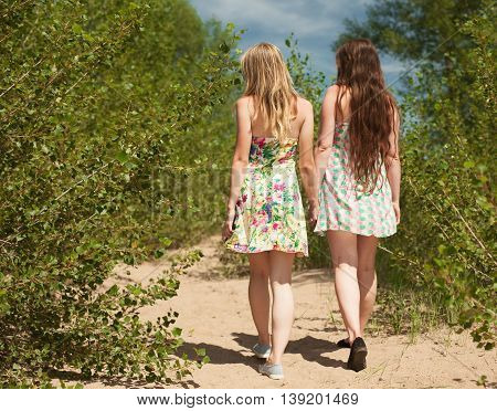Figures Of Two Young Romantic Girls In Green Wood