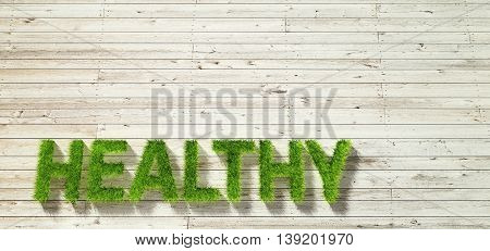 healty made of grass on white wood background