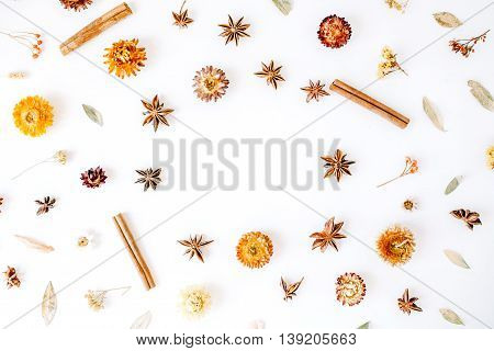 dry flowers cinnamon and cardamom round frame wreath pattern on white background. flat lay top view