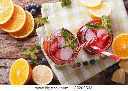 Sangria With Fruit And Berries, Ice And Mint Close Up In A Glass Jar. Horizontal Top View