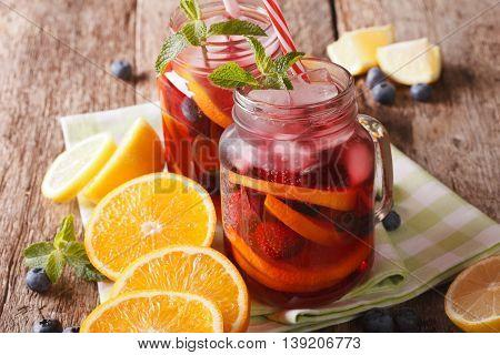 Refreshing Sangria With Orange, Strawberry And Blueberry Closeup. Horizontal
