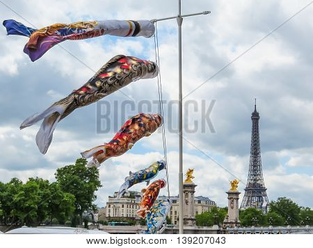 Fish windsock or fish flag and Eiffel Tower as background. Paris, France
