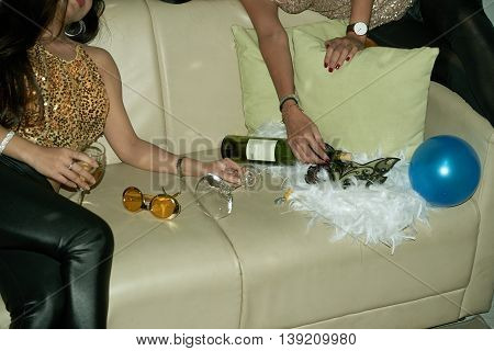 Cropped image of women fell asleep on sofa