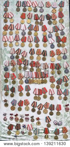 Photo icon jubilee medals and awards of the Soviet Union and Russia which awarded workers and military