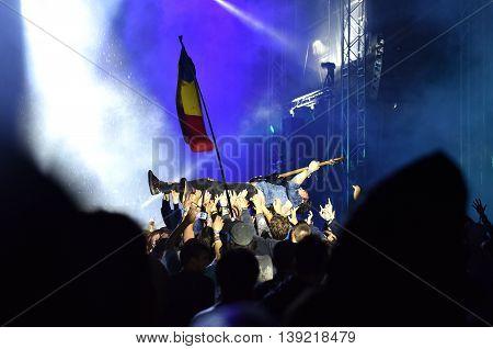 Guitarist Crowd Surfing During A Concert