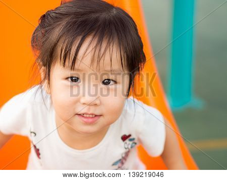 Happy kid asian baby child playing on playground