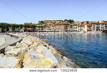 Collioure France - July 16 2016: Tourists enjoy the beach of this coastal village in the south of France Mediterranean sea Languedoc Roussillon Pyrenees Orientales
