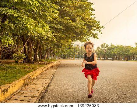 Happy kid asian baby child running in the garden