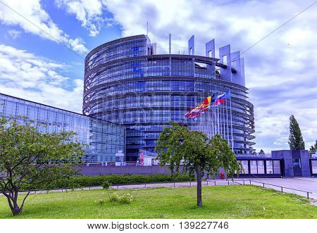 STRASBOURG, FRANCE - JUNE 19, 2016: European Parliament, Louise Weiss building, 1999 in Wacken district of Strasbourg and Ill river