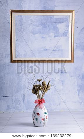 Vintage photo frame and flowers on a blue textured background. Place for your text