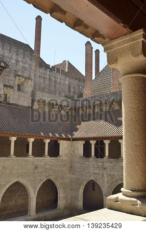 GUIMARAES, PORTUGAL - AUGUST 9, 2016: Courtyard of the Palace of the Dukes of Braganza seen from the upper gallery in Guimaraes in the northern region of Portugal.